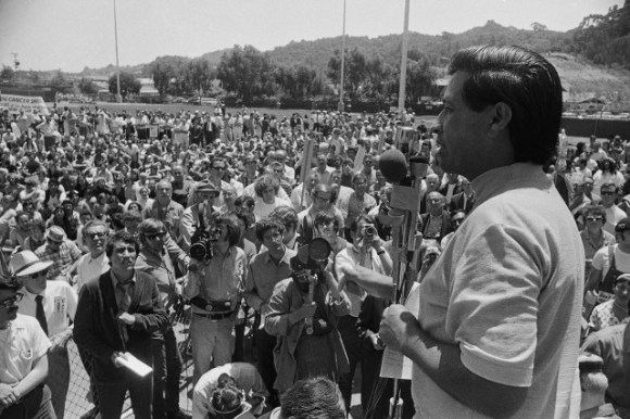 Cesar Chavez, head of the United Farm Workers union, tries to hand UFW literature to the driver of a car entering a Safeway supermarket parking lot in Los Angeles, July 7, 1973.