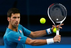 Serbia's Novak Djokovic hits a shot during a training session ahead of the Australian Open tennis tournament, in Melbourne