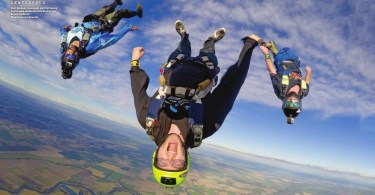 Scott Robinson, Sam Lendle and Chip Keating display some excitement while flocking over Skydive California. Photo by Jessica Brownlow. | Blue Skies Magazine i78: June 2016 | https://blueskiesmag.com