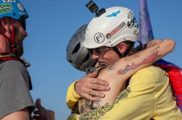 Avery Badenhop hugs his daughter before earning her Tandem BASE number 1 award off a 325 foot building. Team ILL Vision hosts the Acapulco BASE Boogie off the La Palapa hotel - Promoting tourism through Low Altitude Parachute Deployment Demonstration Jumping - Harry Parker Photography - Reflecting the best of your business, product, self.
