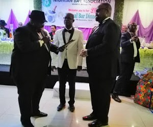 Olumide Akpata receives an award at the annual dinner of the Warri Branch of the NBA