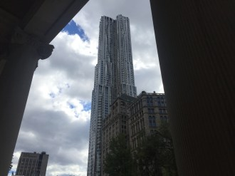 Frank Gehry's New York residential tower, seen from lawn.
