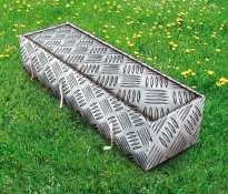 aluminium coffin grass