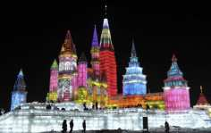 People visit ice sculptures for the upcoming 25th Harbin International Ice and Snow Festival at a park in Harbin