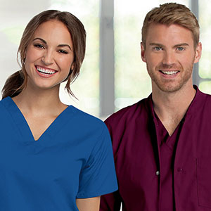 Man and woman with custom embroidered scrubs