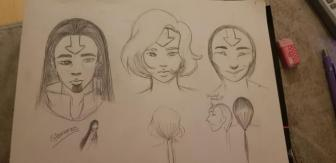 A sketchbook with multiple face designs and hairstyle ideas. designs