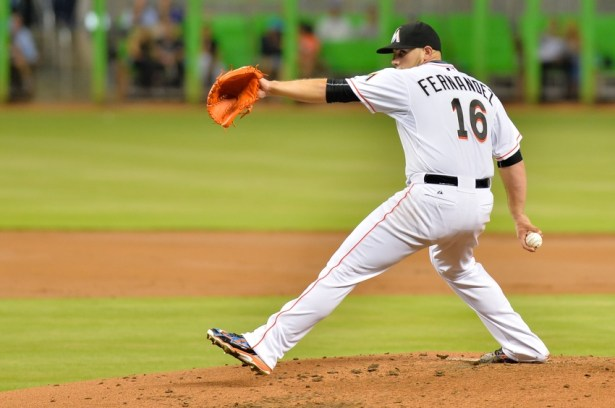 Jul 9, 2015; Miami, FL, USA; Miami Marlins starting pitcher Jose Fernandez (16) delivers a pitch against the Cincinnati Reds during the third inning at Marlins Park. Mandatory Credit: Steve Mitchell-USA TODAY Sports