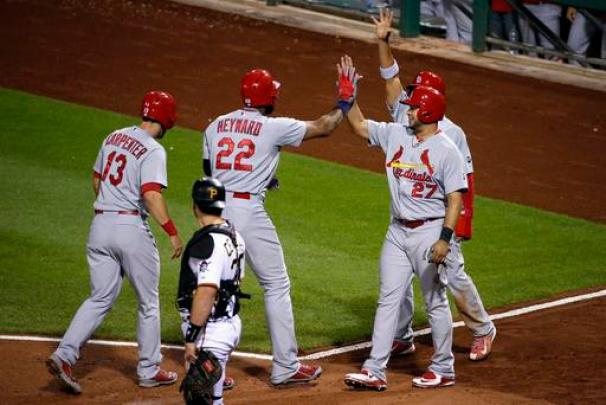 St. Louis Cardinals' Jason Heyward (22) is greeted by teammates Matt Carpenter (13), Jhonny Peralta (27) and Jon Jay after hitting a grand slam off Pittsburgh Pirates pitcher Bobby LaFromboise in the third inning of a baseball game in Pittsburgh, Wednesday, Sept. 30, 2015. (AP Photo/Gene J. Puskar)