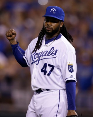 Kansas City Royals starting pitcher Johnny Cueto celebrates the final out of a baseball game against the Detroit Tigers at Kauffman Stadium in Kansas City, Mo., Monday, Aug. 10, 2015. The Royals defeated the Tigers 4-0. (AP Photo/Orlin Wagner)