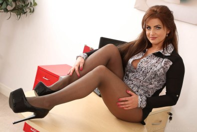 curvy-secretary-in-sheer-black-pantyhose-and-high-heels-08