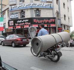 Delivering carpet, Iran