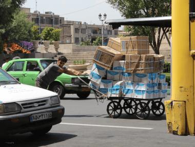 Pushing boxes, Tehran, Iran