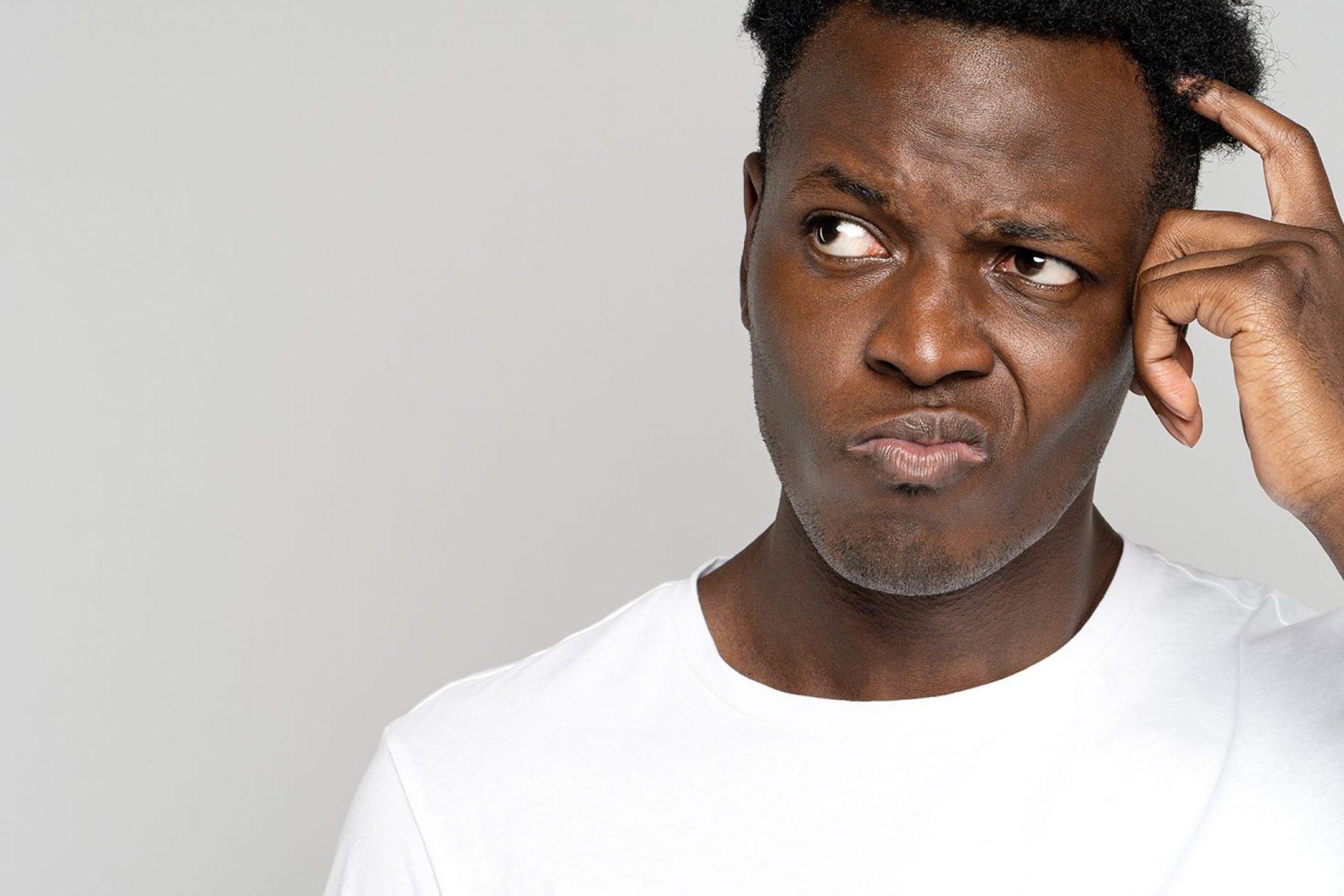 unsure-doubtful-african-man-scratching-head-lookin-smaller
