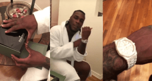 Burna Boy took to Instagram to show off his new diamond-encrusted Audemars Piguet wristwatch he bought for $65,000., which is approximately 23.5Million Naira
