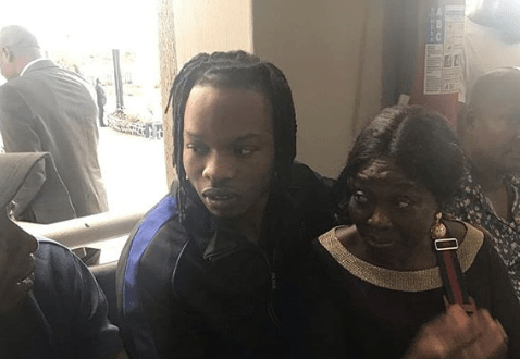 Naira Marley Pictured With His Mother As He Returns To Ikoyi Court