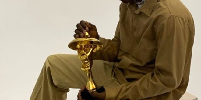 Nigerians React to Adorable Photo of Rema With the Headies Award Plaque