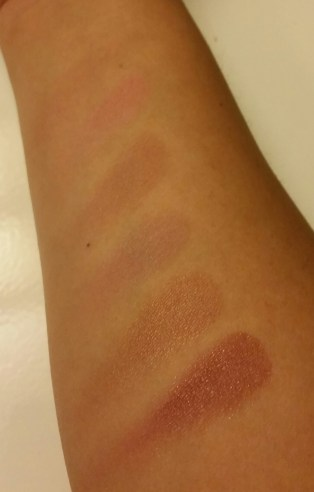 From top to bottom: Clinique Soft-Pressed Powder Blusher in New Clover, Ulta Cheek Color in Girlie, Ulta Cheek Color in Tender, Ulta Cheek Color in Brocade, Ulta Cheek Color in Sun Kissed, Ulta Cheek Color in Adore