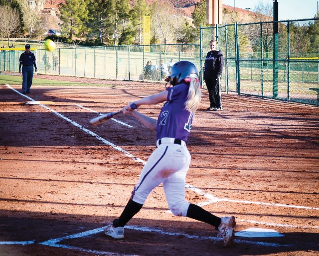 Sydney White, LHS pitcher, swings for the fence. Photo credit: Riley Livingston