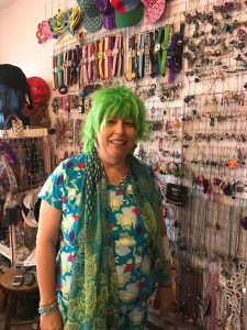 Rebekka Smith in front of her organized jewelry wall.  On this day she was looking for frog themed items.