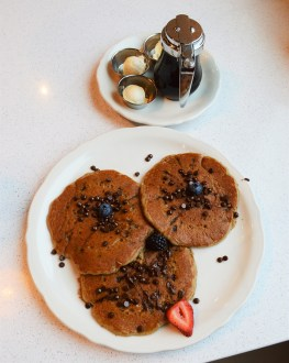 """Happy pancakes upgraded to chocolate chip and adjusted """"happy face"""" to please a picky eater. 