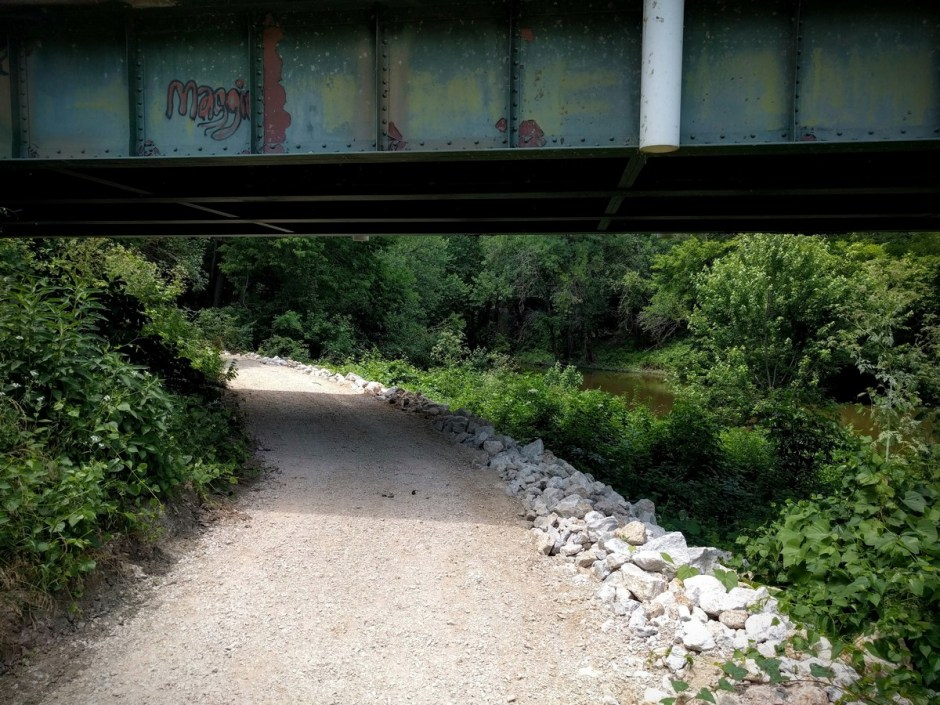 The trail passes beneath the State Street Bridge, which spans Elm Creek.