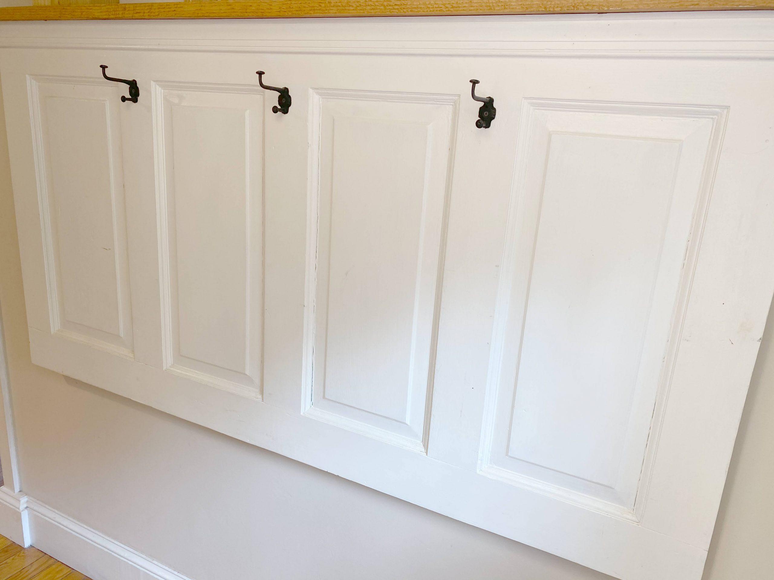 gorgeous old door turned coat rack