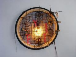 Exit – 37 x 27 x 7.5 Bicycle tire, lettering, lamp and the springs from an old car seat.