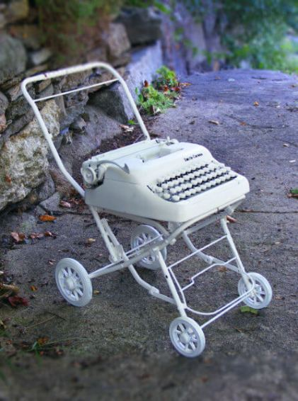 Stroller – 13 x 24 x 26 Mixed media. A portable typewriter mounted on a doll's baby stroller.