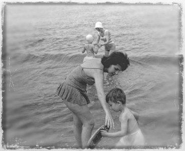 Barbara keeping an eye on Paul as a toddler.