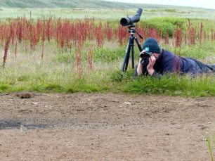 WWTs-Roland-Digby-in-the-field-in-Chukotka-using-Leica-optics1-1025x769