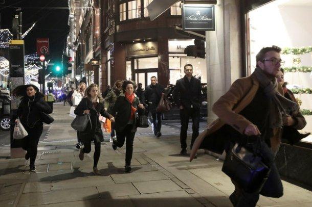 People run down Oxford Street, London