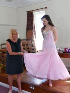 Explaining how the dresses are made