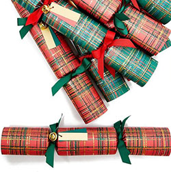 A stack of tartan Christmas crackers in red and green tartan