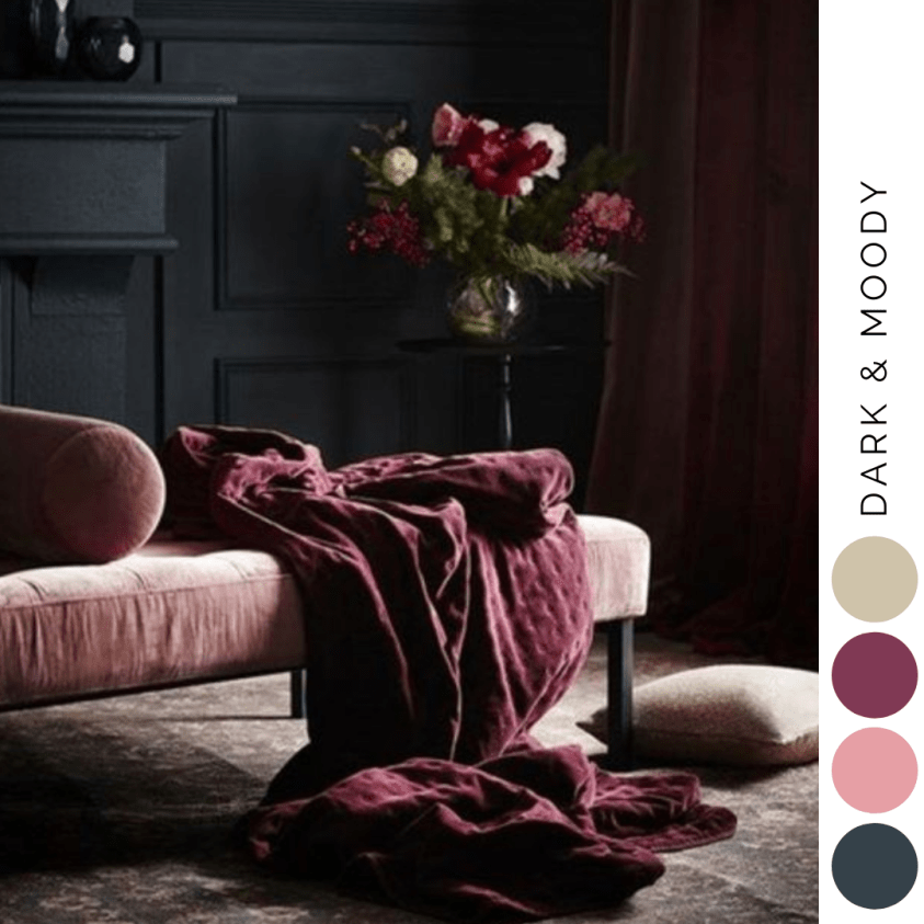 Dark living room with pink and burgandy colour scheme and black walls