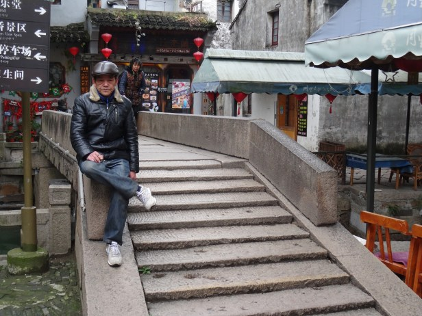 Sittin doin nothin Tongli Water Town Suzhou China