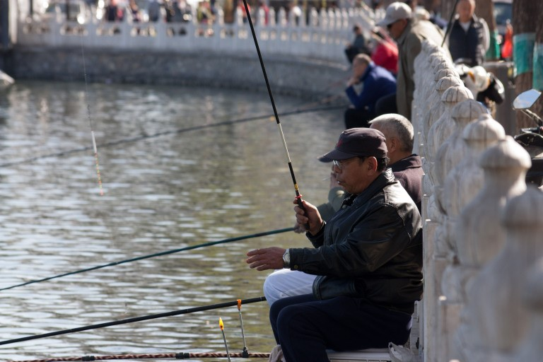 Many Chinese in Beijing love to fish during spring. Photo © Timothy Van Gardingen