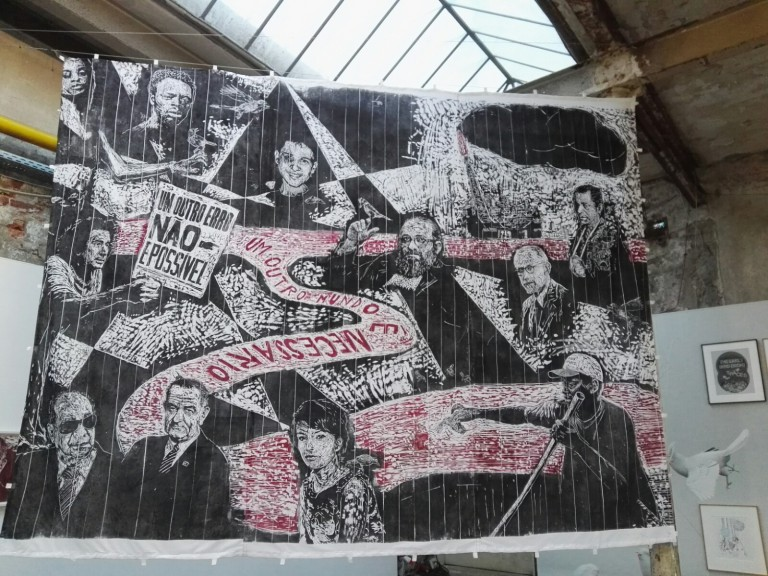 "At WERKSCHAU exhibit: ""another world is necessary - or: don't think about the crisis - fight!"" Thomas Kilpper. Print on raw canvas, wood cut on the floor of the Vila Flores cultural center in Porto Alegre. © VG Bildkunst Bonn"