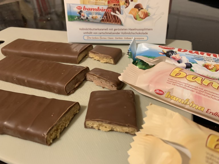 Several Bambina candy bar varieties cut open with wrappers