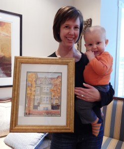 Happy homeowner with her very cute baby