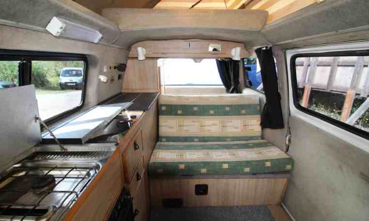 kitchen space in bed space in Fridge space in side view of VW T25 Crusader campervan