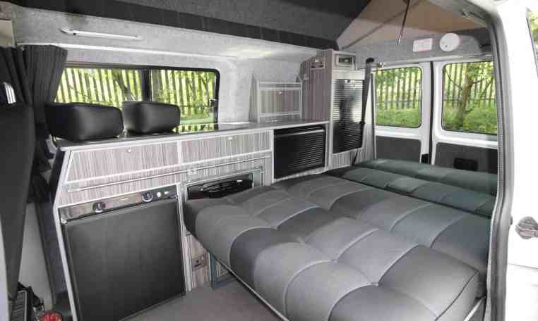 Bed unfolded in Kitchen area in Crusader Campervan