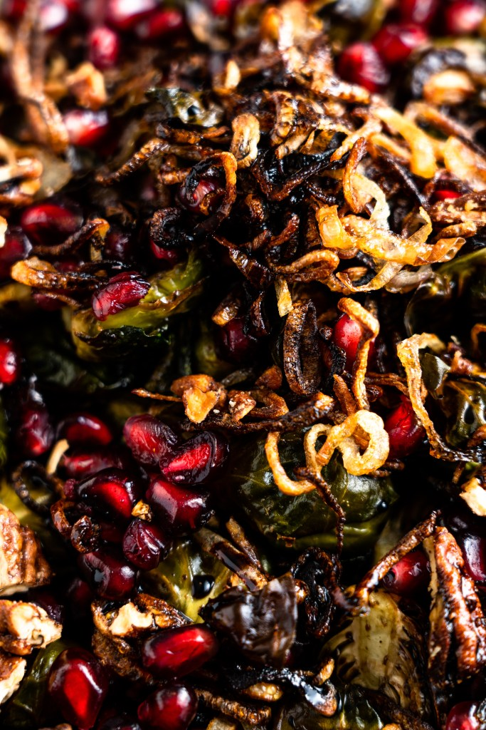 Air Fryer Brussels Sprouts with Spicy Nuts, Crispy Shallots, Balsamic Glaze and Pomegranate Seeds