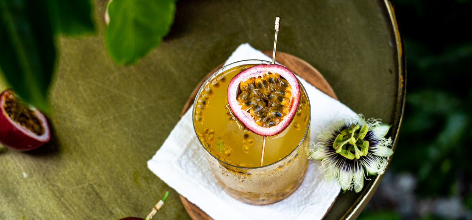 A header shot of a passion fruit gin and tonic.