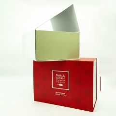 White cardboard laminated surface with grey board interior in a collapsible style which can ship flat for ease of transport