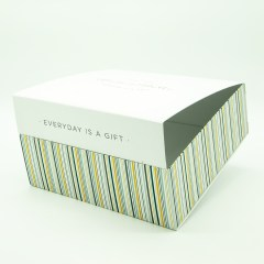White cardboard laminated surface with greyboard interior in a collapsible style which can ship flat for ease of transport