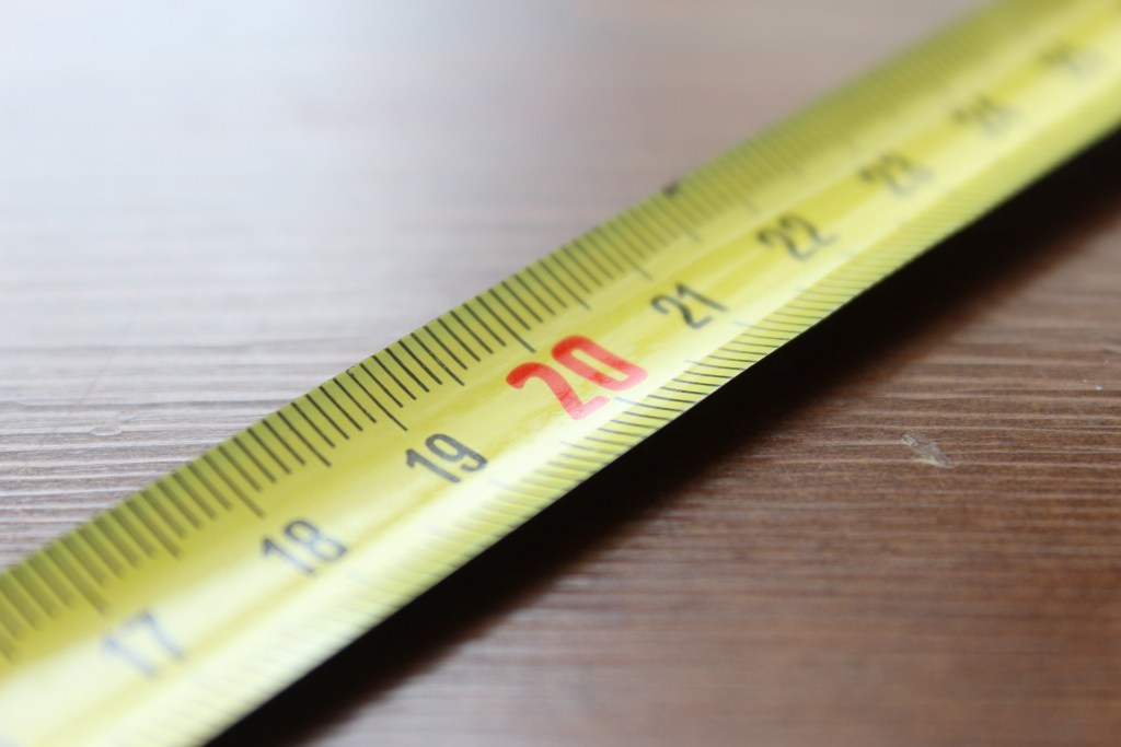 conversions of length measurements is very important in packaging. picture of a measuring tape