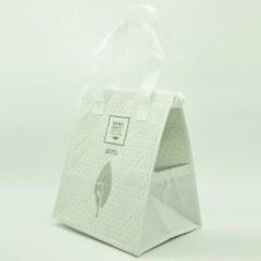 non-woven bag with aluminum insulation, heat-pressed dots and cross stitched handles