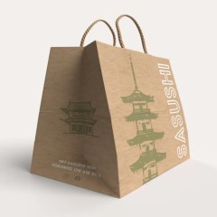 brown Kraft paper bag with a focus on side gusset printing and twisted paper handles to match its base