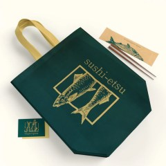 suite of packaging including heat sealed reusable bag, utensil bag and business cards all in an emerald green and gold colour scheme