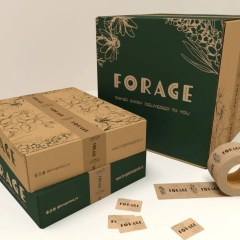 brown Kraft base boxes with dark green print and custom branded Kraft tape